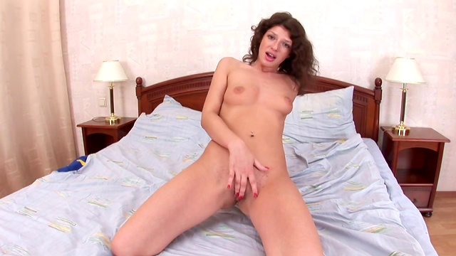 Solo girl spreads legs waistband shows that trimmed pussy
